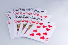 Cartões de jogo do resplendor real do pôquer Foto de Stock