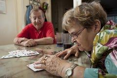 Cartões de jogo dos séniores Fotografia de Stock Royalty Free