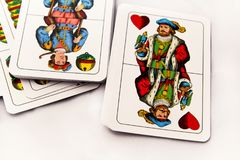 Cartões de jogo em um fundo branco, fim acima Imagens de Stock Royalty Free