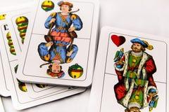 Cartões de jogo em um fundo branco, fim acima Fotografia de Stock Royalty Free
