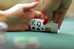 Cartões de jogo nas mãos Foto de Stock