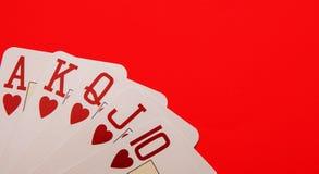 Cartões de jogo que mostram um resplendor real da lareira fotografia de stock