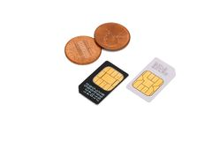 Cartões de SIM para telemóveis e moedas Imagem de Stock