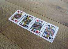 Cartões do pôquer em um backround de madeira, no grupo de jaques dos clubes, nos diamantes, nas pás, e nos corações Fotografia de Stock Royalty Free