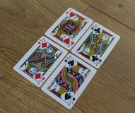 Cartões do pôquer em um backround de madeira, no grupo de jaques dos clubes, nos diamantes, nas pás, e nos corações Imagens de Stock