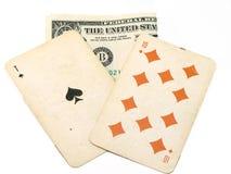Cartões e dólar velhos de jogo Imagens de Stock Royalty Free