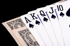 Cartões reais nivelados com dinheiro Fotografia de Stock Royalty Free