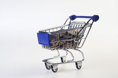 Cart. Shopping cart full with coins royalty free stock photo