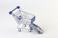 Cart. Shopping cart with car on white background stock photo