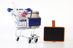 Cart. Shopping cart with bags and sign stock photography