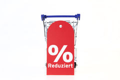 Cart. Shopping cart with discount sign stock images