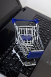 Cart. Online shopping - shopping cart on notebook royalty free stock image