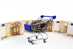 Cart. Shopping cart with money on white background royalty free stock photography
