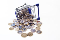 Cart. Shopping cart with coins on white background royalty free stock photos
