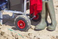 Cart for angling equipment on the beach. Fisher cart on sea angling competition at the beach, Huelva, Spain Royalty Free Stock Images