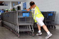 Cart Associate. Walmart Job is a physical hard job stock photos