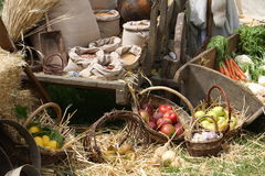 Cart and baskets with fruit and vegetables for sale at Royalty Free Stock Photos