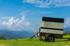 Cart with billboard against rural background Royalty Free Stock Image