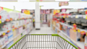 Cart in blurred supermarket or department store. Shopping concept Royalty Free Stock Photography
