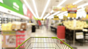 Cart in blurred supermarket or department store. Shopping concept Royalty Free Stock Image