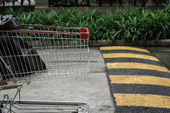 Cart crossing speed bump. On the road royalty free stock image