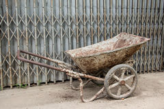Cart. Dump old cart with two wheels used in construction Royalty Free Stock Photos