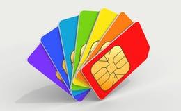 Cart?es coloridos do telefone SIM em uma plataforma Imagem de Stock Royalty Free