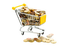 Cart and euro coins. A shopping cart is filled with well-euro coins, symbolic photo for purchasing power and consumption Stock Images