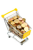 Cart and euro coins. A shopping cart is filled with well-euro coins, symbolic photo for purchasing power and consumption Stock Photos