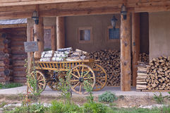 The cart of firewood. In the backyard of the village inn Stock Photos
