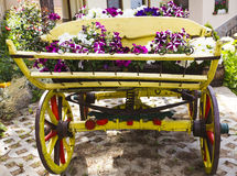 Cart with flowers Stock Images
