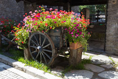 Cart of flowers. Photo of a cart of flowers in a mountain village Royalty Free Stock Image