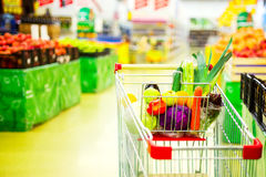 Cart with fresh fruits and vegetables in shopping centre Royalty Free Stock Photo