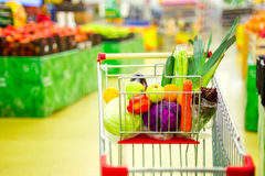 Cart with fresh fruits and vegetables in shopping centre Stock Photos