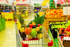 Cart with fresh fruits and vegetables in shopping centre Royalty Free Stock Image