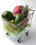 The cart of fruit 1. Purchase of fruit in a supermarket royalty free stock images