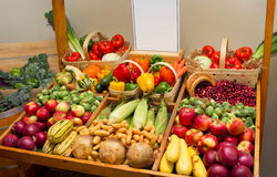 Cart with fruits and veg and a blank sign Royalty Free Stock Image
