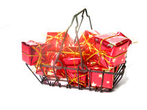 Cart full of gifts. Shopping cart full of boxed gifts over white Stock Photos