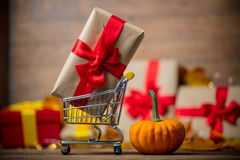 Cart full of gifts for Halloween near a little pumpkin Stock Photography