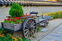 Cart in the garden with flower Royalty Free Stock Images