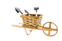 The cart  with garden tools isolated over white Royalty Free Stock Photos