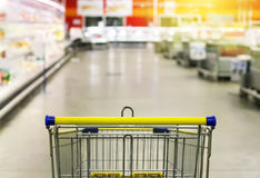 Cart at the grocery store. Abstract blurred photo of store with trolley in department store bokeh background. Stock Images