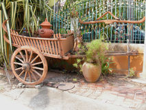 Cart. An historical conveyance decorating the entrance to a holiday condominium resort in Pattaya, Thailand Stock Photo