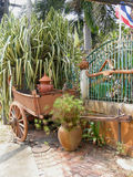 Cart. An historical conveyance decorating the entrance to a holiday condominium resort in Pattaya, Thailand Stock Image