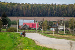 A cart with a horse in a Russian village. Stock Photo