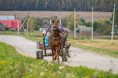 A cart with a horse in a Russian village. Royalty Free Stock Photography