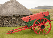Cart and a hut Royalty Free Stock Images