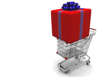 Cart with a large gift. Story light cart with a large gift on it, packed in the red decorative wrapping royalty free stock photo