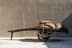 Cart loaded with coffee bags. Old wooden cart loaded with coffee bags stock photos