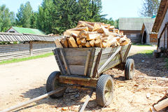 The cart loaded sawn timbers. On a sunny day Stock Photo